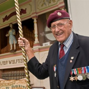 Joe Davies standing by the Lady Wulfrun Fair Organ - Proudly displaying his WWII medals and Police Long Service Medal